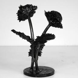 Sculpture représentant udes fleurs de chardons en gouttes d'acier Fleurs Chardons LX