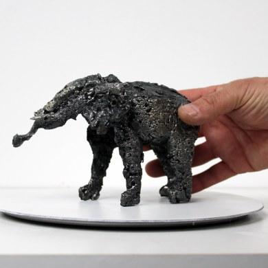 Sculpture de Philippe Buil en metal Dentellede Bronze et d'acier représentant un elephant Piece unique Sculpture of Philippe Buil in metal Bronze and steel lace representing an elephant Unique Piece